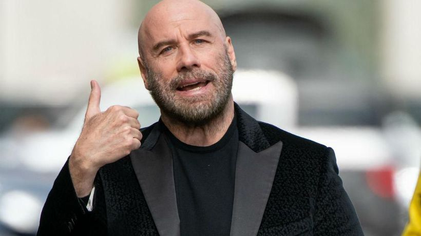 Bald John Travolta encouraged by Pitbull