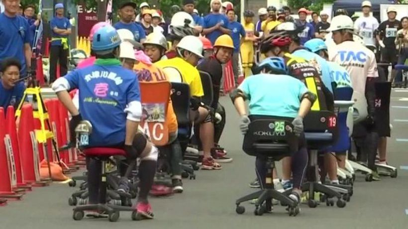 Office chair racers compete in 'grand prix'