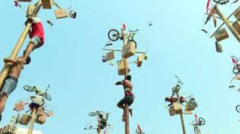 Greasy pole contest celebrates Independence Day