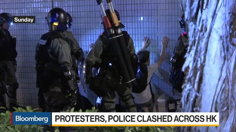 Police, Protesters Clash Across Hong Kong