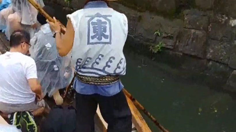 Duck under bridges on a boat tour in Japan's city of water