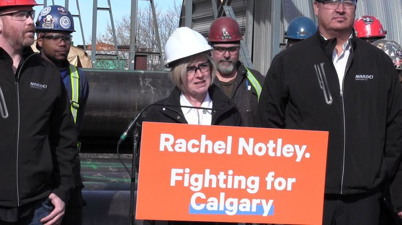 Rachel Notley campaigns at a pipe yard in Calgary