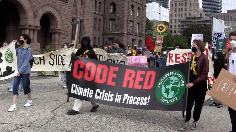 Hundreds rally outside Queen's Park to demand immediate climate change action