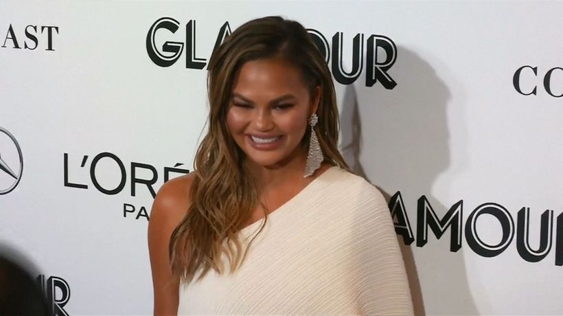 Chrissy Teigen chipped tooth while filming 'Family Feud'
