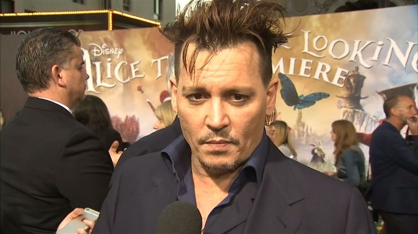 Johnny Depp's trial date with ex-lawyers delayed