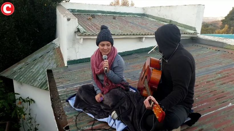 Duo perform songs on their rooftop to keep them sain during lockdown