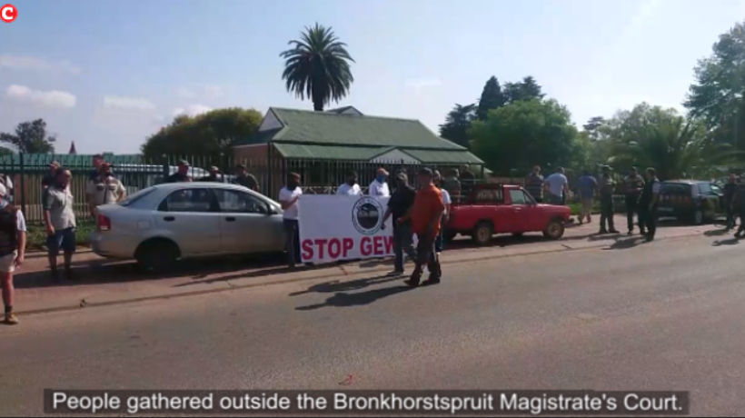 People gathered outside the Bronkhorstspruit Magistrate's Court.