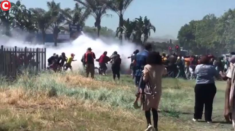 Police use teargas and water cannons to disperse the crowds at Brackenfell