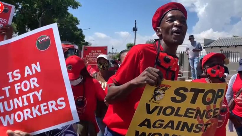 Community health workers protest outside World AIDS day commemoration event