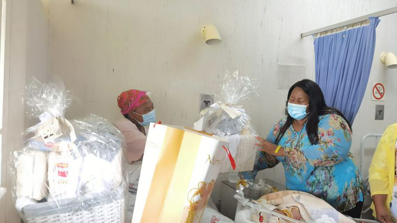 Nompumelelo Mazwi gives birth to the first Christmas baby at Carltonville Hospital.