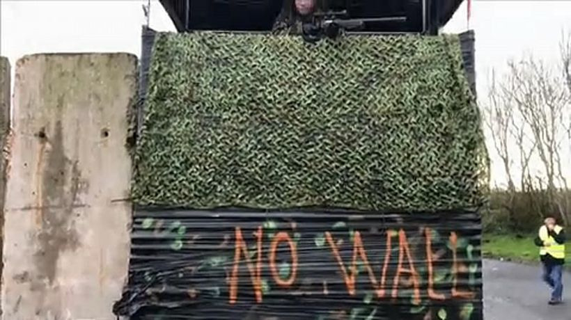 Raw Politics - Raw Moment: Protesters dressed as soldiers create 'Brexit border wall' on island of Ireland