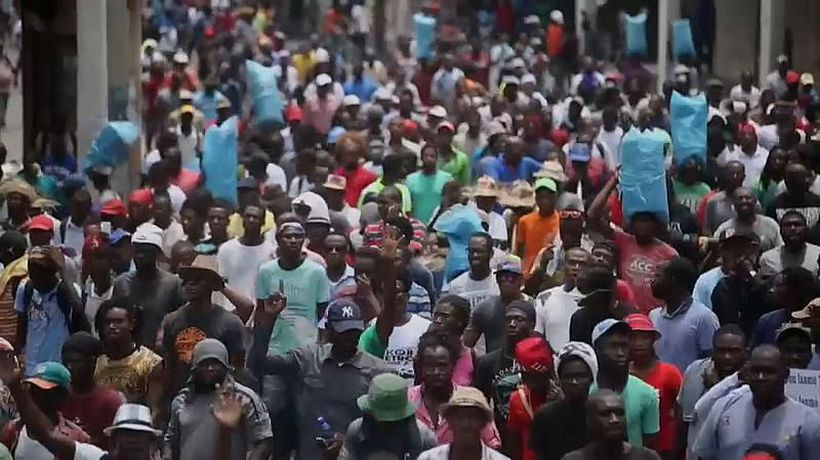 Haitian capital halted as protesters call for president to quit