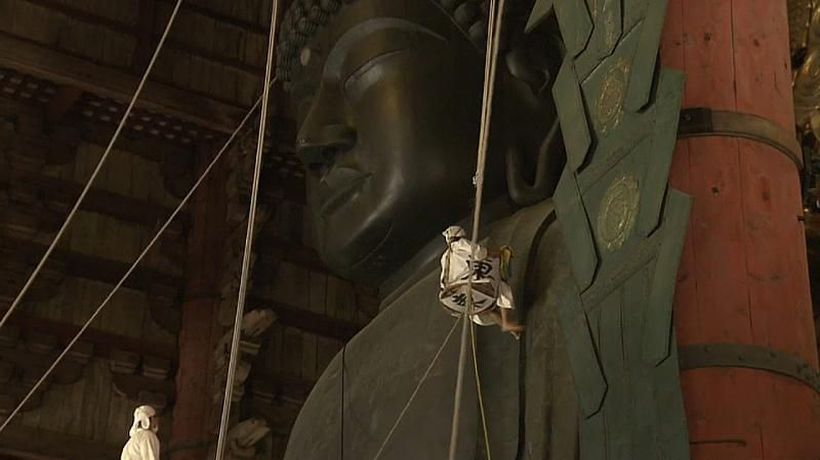 Watch: Worshippers dust the statue of Buddha ahead of festival