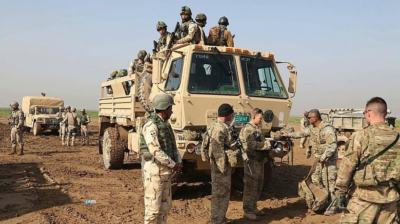 US and Spain hand over base to Iraq as allied retreat continues