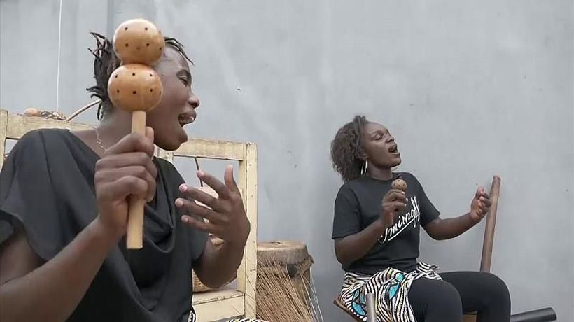 Female group make music with kitchen items to highlight women's daily reality in Republic of Congo