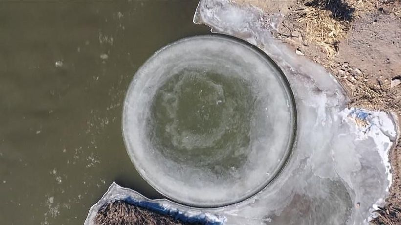 Rare spinning ice disc spotted on China river
