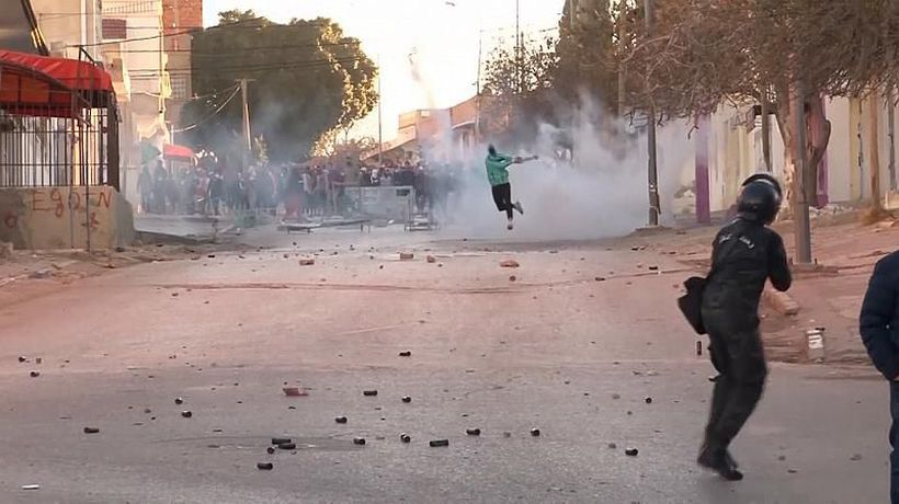Tunisian police continue to clash with protesters as poverty still rife 10 years after revolution