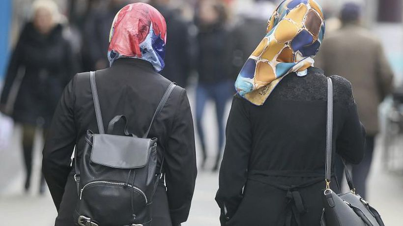 Employers can ban workers from wearing headscarves or religious symbols, ECJ rules
