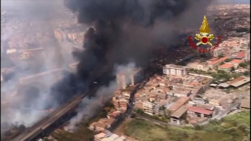 Firefighters battle flames as fires force evacuations in Catania