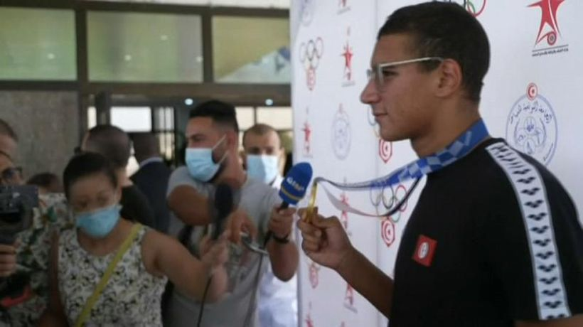 Heroic welcome for Tunisia's 18 year old Olympic king Ahmed Hafnaoui