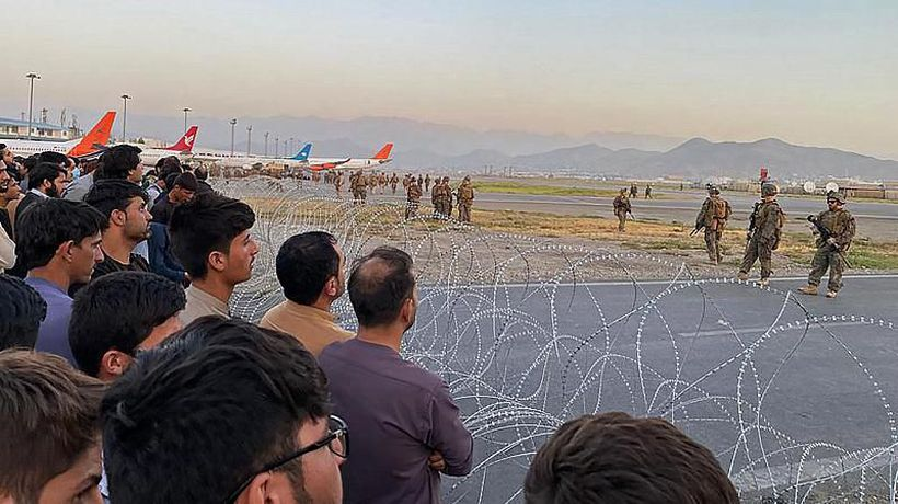 Afghans cling to departing US military plane as desperation grows at Kabul airport