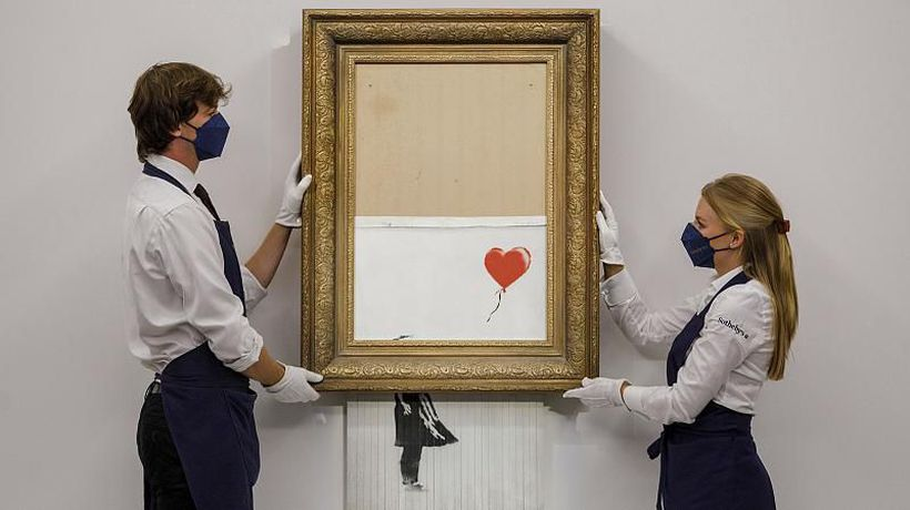 'Love is in the Bin': Shredded Banksy artwork sells for nearly €22 million at auction