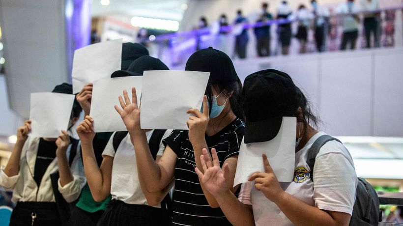 'Our heart will never die': Hongkongers raise blank paper in protest against security law