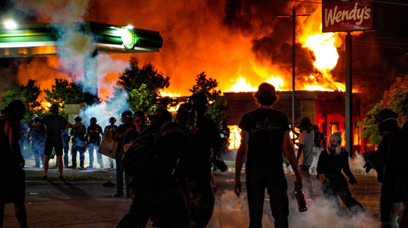 Rayshard Brooks: protesters set fire to Wendy's after black man shot dead by police