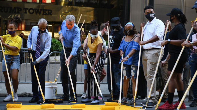 New York City mayor helps paint Black Lives Matter mural outside Trump Tower