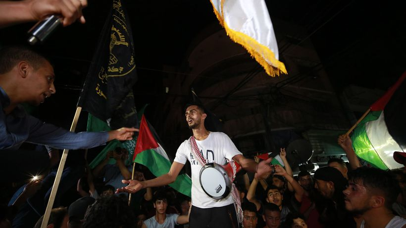Palestinians greet ceasefire with celebrations on the streets of Gaza