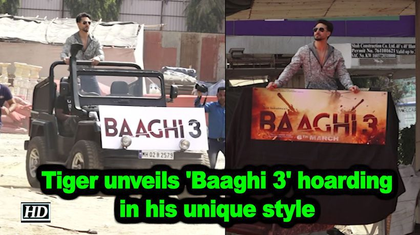 Tiger Shroff unveils Baaghi 3 hoarding with his unique style