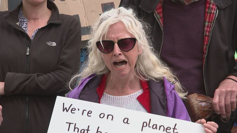 Wailing climate protester outside the Treasury