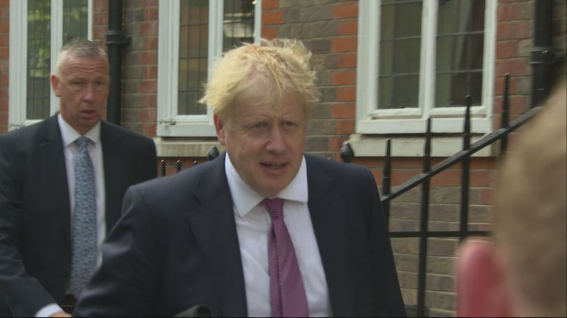 Boris Johnson arrives at campaign headquarters in London