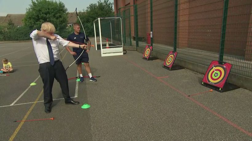 Boris tries archery at children's summer camp