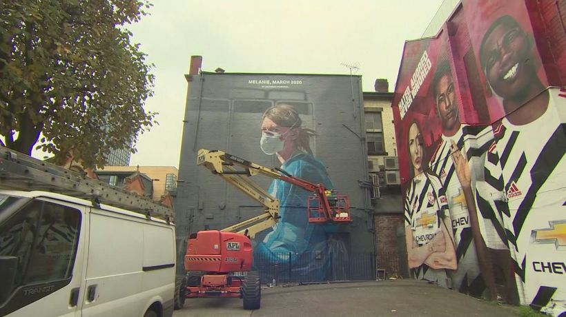 Manchester mural adapted from NHS worker portrait