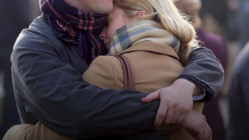 What are the physical and psychological benefits of being able to hug again?