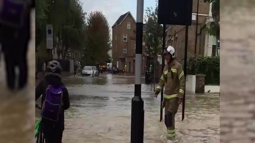 Firefighters evacuate residents as burst water main floods London street
