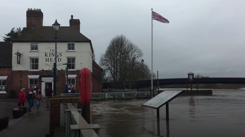 Locals plough on with their day as floodwaters rise in Worcestershire
