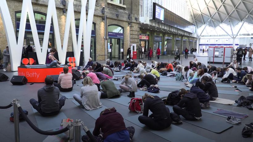 Fitness Class held in empty King's Cross concourse in aid of charity Mind