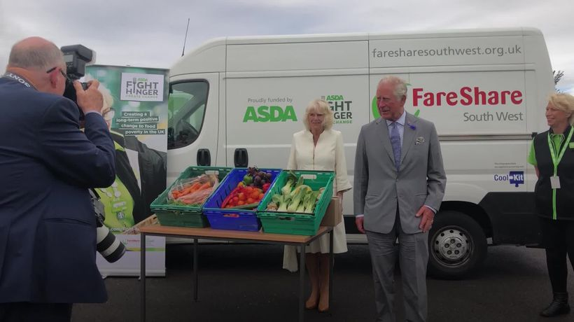 Charles and Camilla visit Asda distribution centre and shirt factory