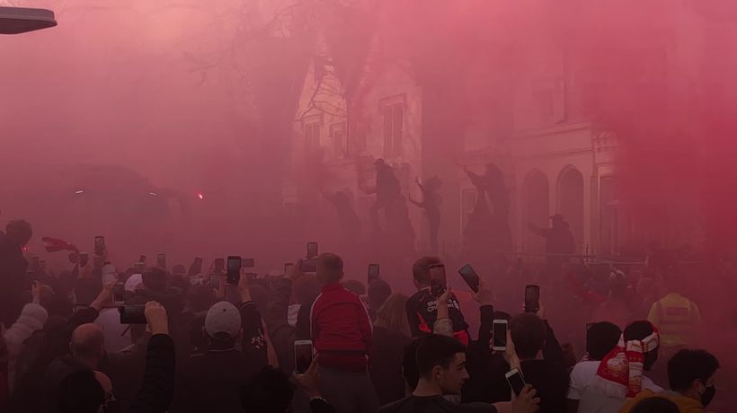 Crowds of fans greet Liverpool bus as it arrives at Anfield