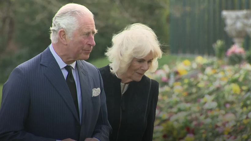 Charles and Camilla view flowers left in memory of Philip