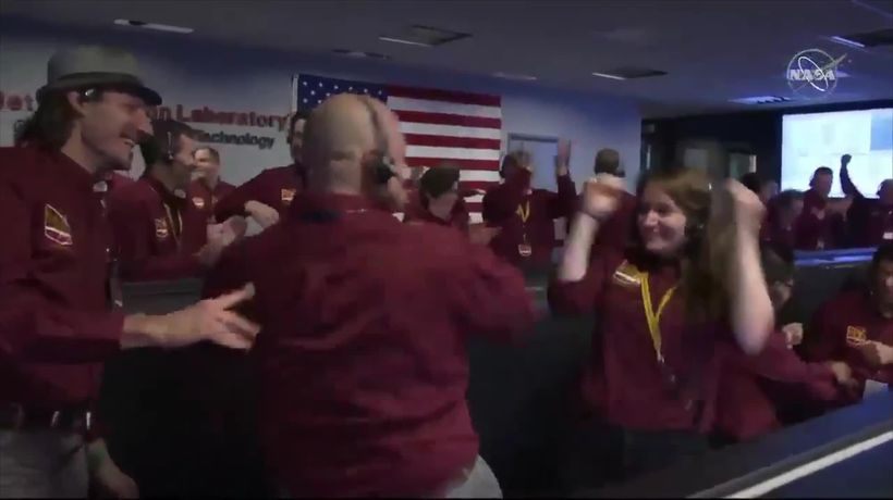 Nasa scientists celebrate Mars landing with elaborate handshake