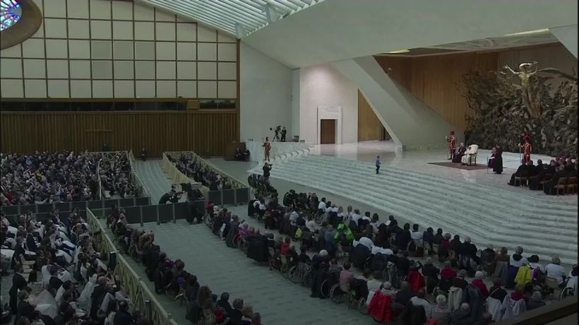 Child runs onstage during Pope's address to Vatican audience hall