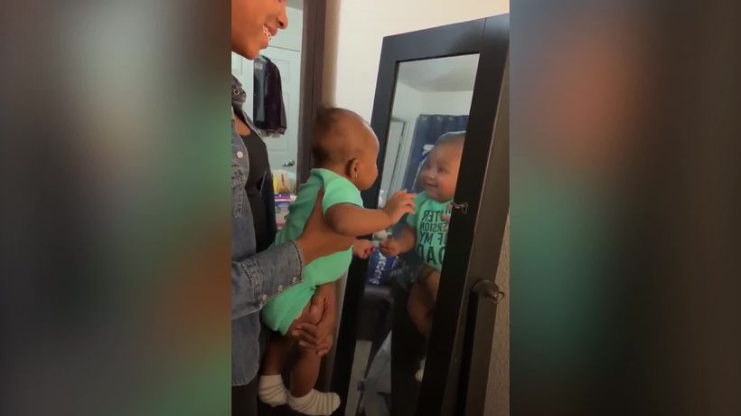 Meet the baby who loves her own reflection