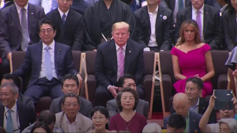 Donald Trump watches sumo wrestling in Japan