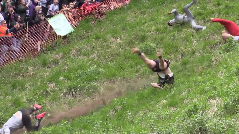 Competitors take on death-defying Cheese Rolling Race