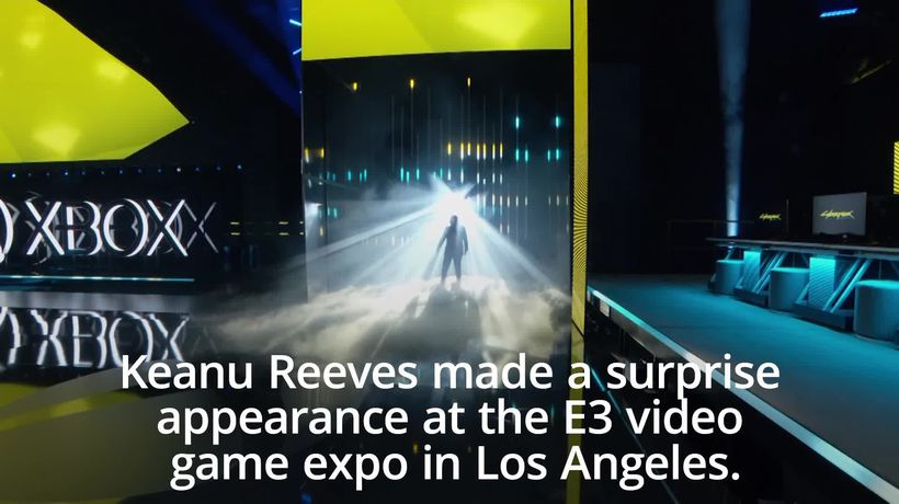 Keanu Reeves makes surprise appearance at video game expo E3