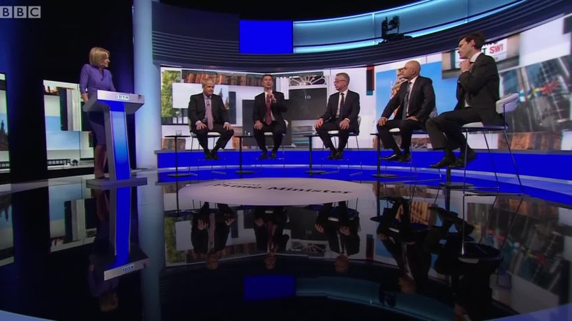 Rory Stewart removes his tie during the Tory leadership debate
