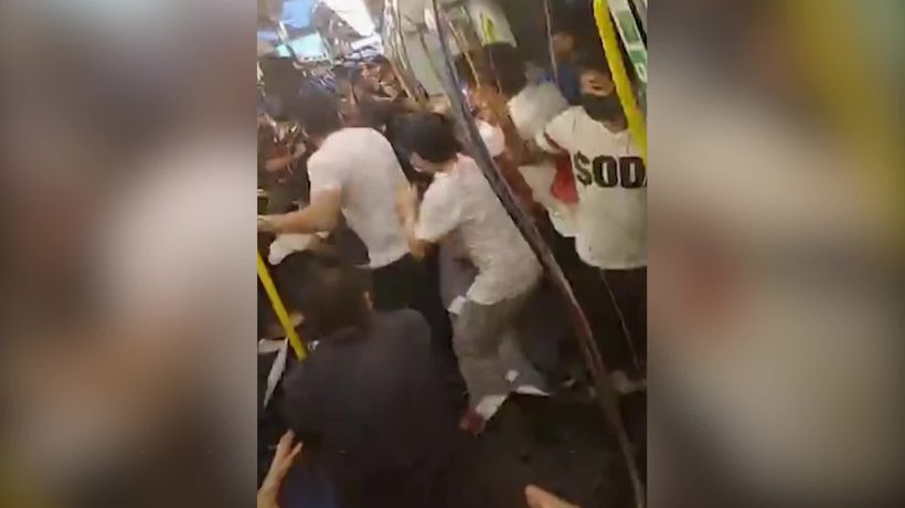 Hong Kong protesters violently attacked in metro station